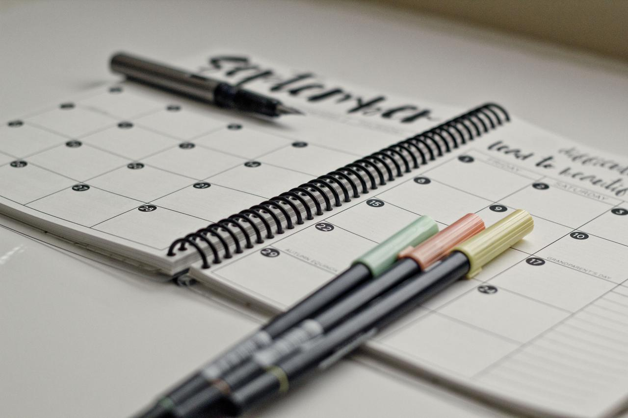 colored pensils on a day planner
