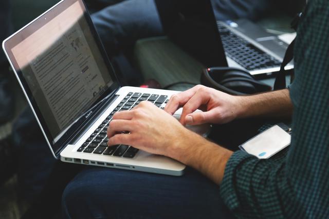 laptop remote working writing typing