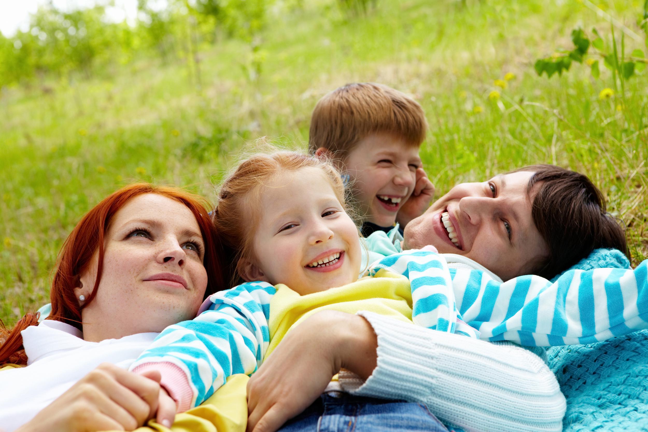 Happy family of four EveryPixel com