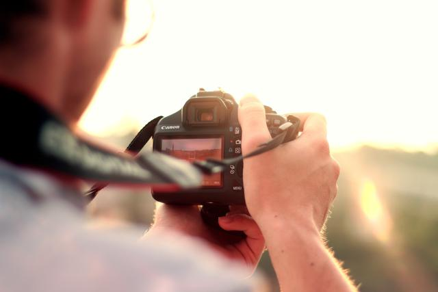 man camera taking photographer